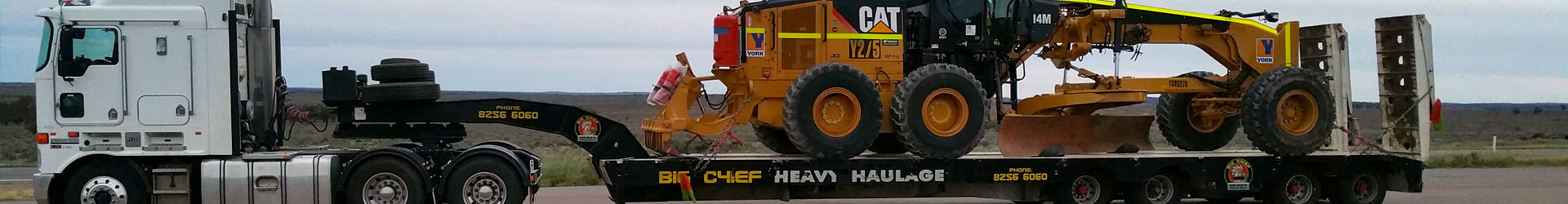 Big Chief Heavy Haulage Transport Truck with grader on trailer